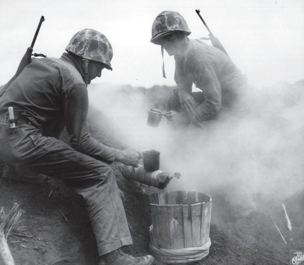 Marines had no shortage of derogatory words to describe the day-to-day life on Iwo Jima. With most of their time spent dislodging a tenacious and fanatical enemy, mundane moments like making a cup of coffee (seen here) were a welcome thing. Here, two Marines use a hot sulfur spring as a heating device. MARINE CORPS HISTORICAL CENTER PHOTO