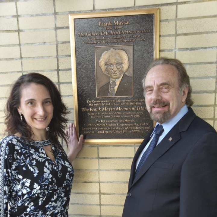Dawn F. Massa Stancavish and Donald P. Massa with company founder Fra nk Massa's Memorial Plaque at the entrance of the Massa Products Corporation Facility in Hingham, MA