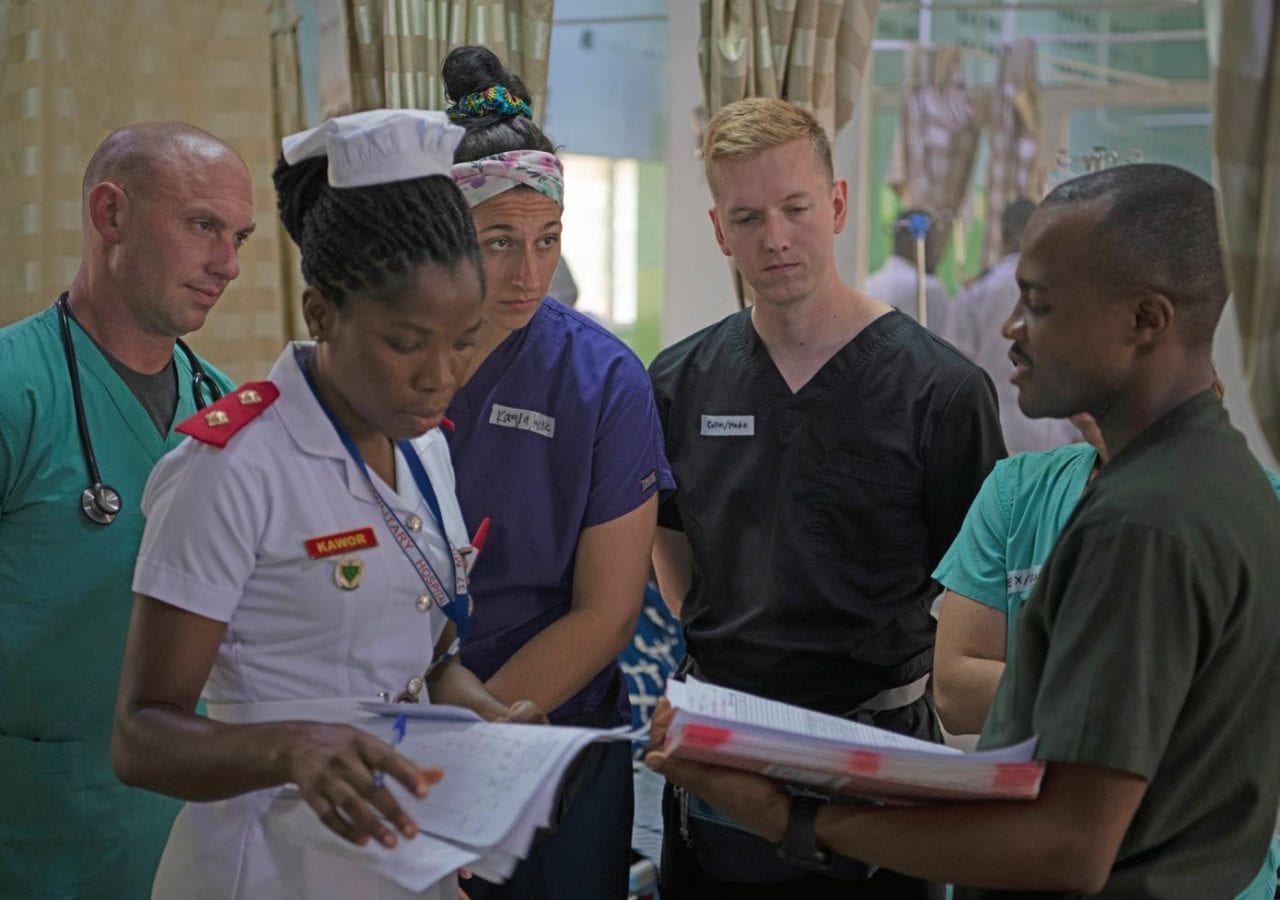 U.S. Army and Ghanaian medical professionals discuss medical practices during Medical Readiness Exercise (MEDREX) 19-3 at Accra, Ghana, on June 10, 2019. MEDREX exercises in support of U.S. Army Africa allow U.S. forces to train in an alternatively resourced environment, share medical practices, and build lasting relationships with medical professionals from participating African partner nations.