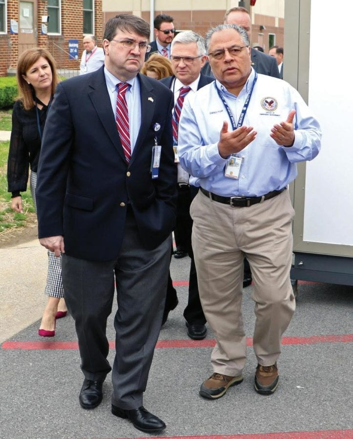 Dr. Paul Kim (right), director of the VA Office of Emergency Management, briefs VA Secretary Robert Wilkie on response capabilities.
