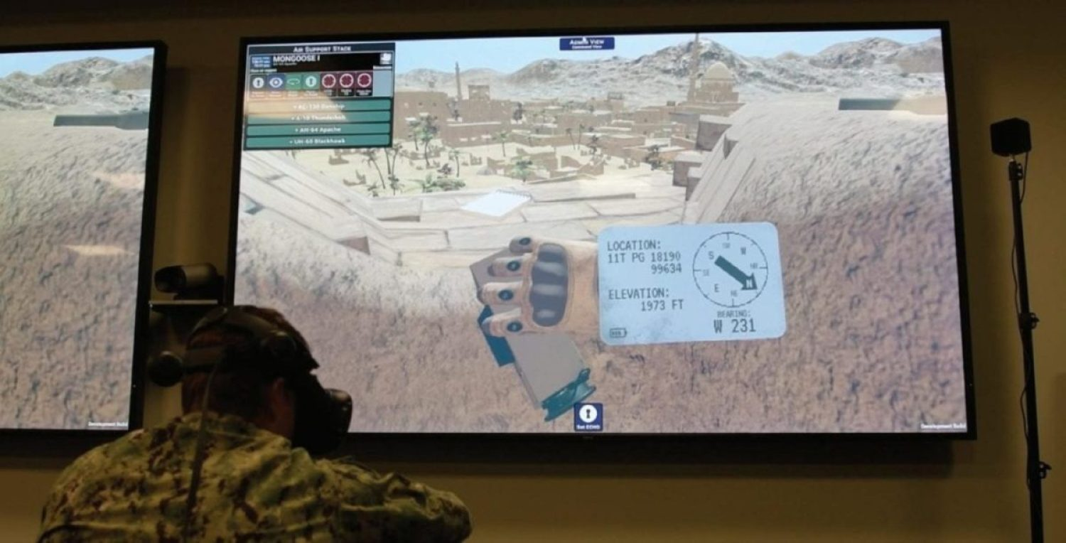 Special Operator 1st Class Brad Denn demonstrates innovative virtual reality joint tactical air controller (JTAC) training equipment at Naval Special Warfare Command (NSWC).
