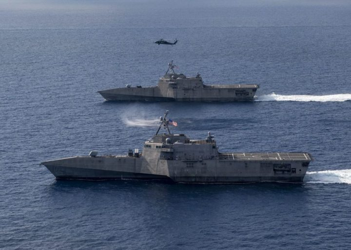 The Independence-variant littoral combat ships USS Gabrielle Giffords (LCS 10), bottom, and USS Montgomery (LCS 8) operate in the South China Sea, accompanied by an MH-60S Sea Hawk of Helicopter Sea Combat Squadron (HSC) 23, Jan. 28, 2020. (U.S. Navy photo by Mass Communication Specialist 2nd Class Chris Roys/Released)