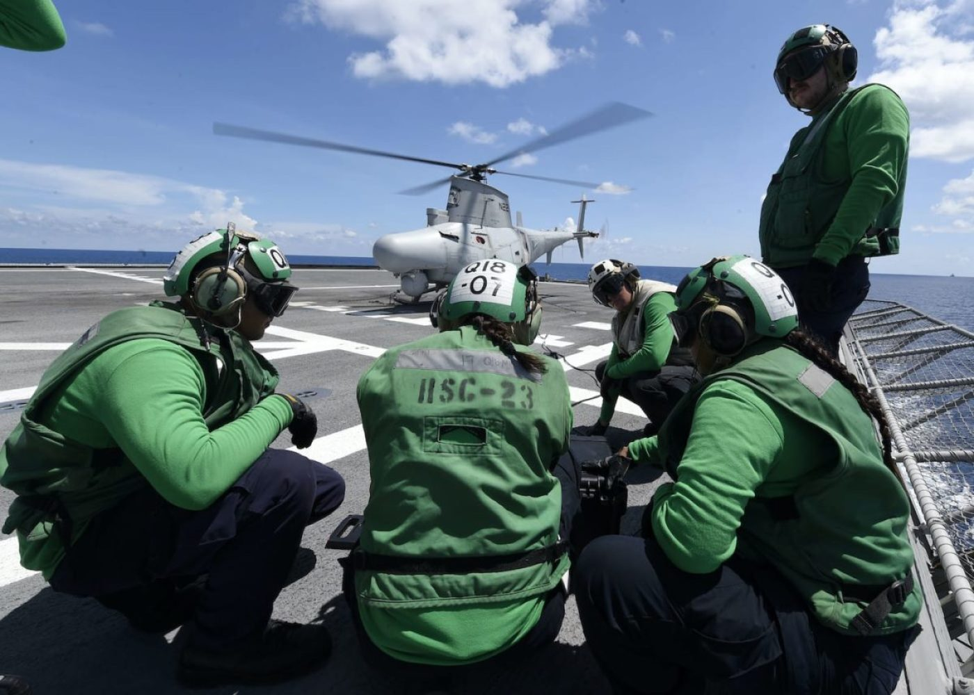 """Sailors assigned to the """"Wildcards"""" of Helicopter Sea Combat Squadron (HSC) 23 run diagnostics on a MQ-8B unmanned helicopter on the flight deck of the Independence-variant littoral combat ship USS Gabrielle Giffords (LCS 10), May 14, 2020. (U.S. Navy photo by Mass Communication Specialist 2nd Class Brenton Poyser)"""