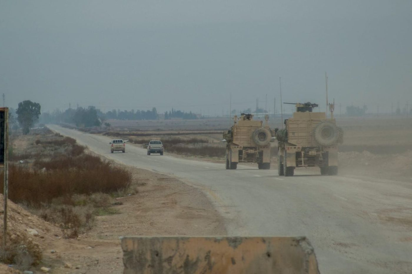 Members of Syrian Democratic Forces (SDF) lead a Coalition convoy in Deir ez-Zor province, Syria, Nov. 19, 2018. Coalition forces face the threat of ISIS-set improvised explosive devices daily, but the SDF continue to safeguard and protect Coalition forces on all military convoys in the region. Continued assistance to partner forces is essential to setting conditions for regional stability. The Coalition and its partners remain united and resolved to prevent the resurgence of ISIS and its violent extremist ideology. (U.S. Army photo by Sgt. Matthew Crane)
