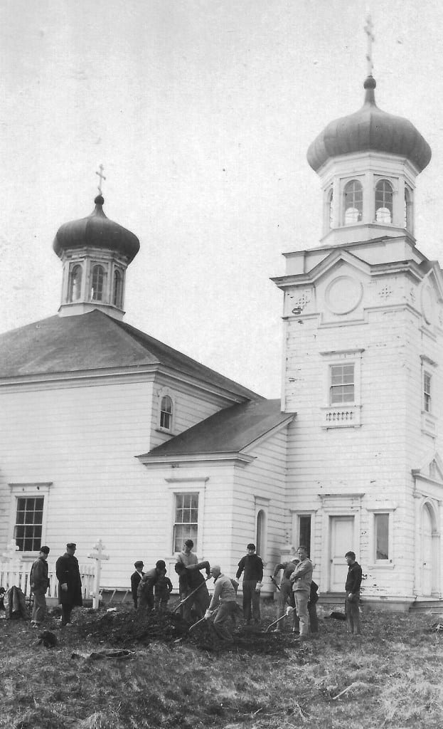 Crew members of Unalga burying the dead at the Russian Orthodox Cathedral. (NOAA)
