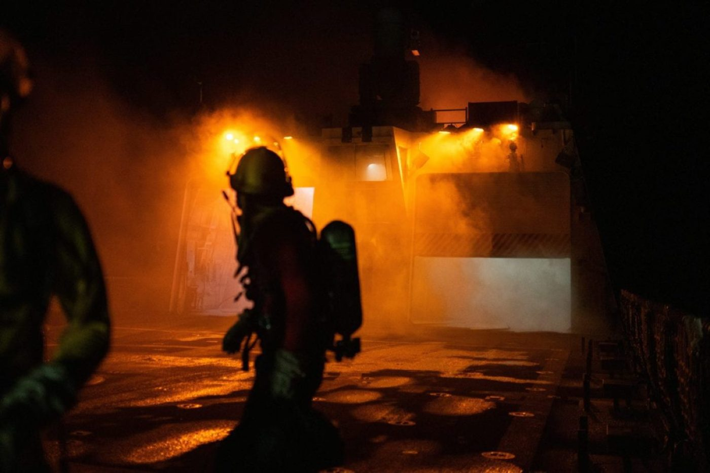An investigator on board the Coast Guard Cutter Waesche, looks back towards the superstructure of the cutter in the Western Pacific Ocean, September 19th 2020. The Waesche's deployment to the region was in direct support of the U.S. Foreign Policy and National Security objectives in the region as outlined by the National Defense Strategy. (Coast Guard Photo by Petty Officer 3rd Class Aidan Cooney)