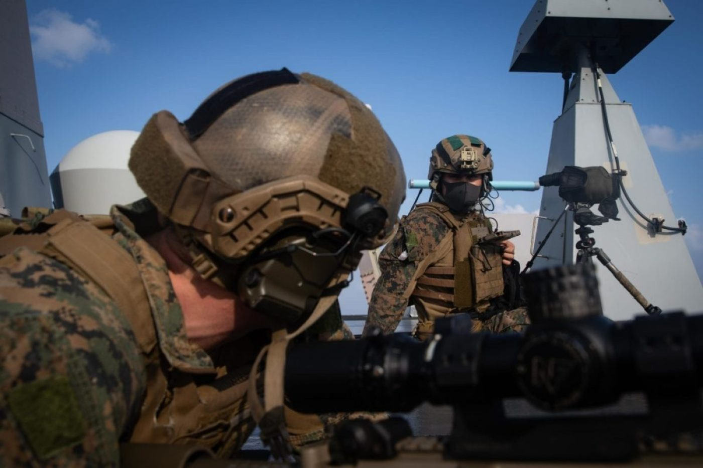 Cpl. Brady Rick, left, and Cpl. Edward Gonzales, a sniper team with 31st Marine Expeditionary Unit's (MEU) Amphibious Raid Force, adjust their position during a simulated visit, board, search, and seizure (VBSS) mission aboard USS New Orleans (LPD 18). (U.S. Marine Corps photo by Sgt. Audrey M. C. Rampton)