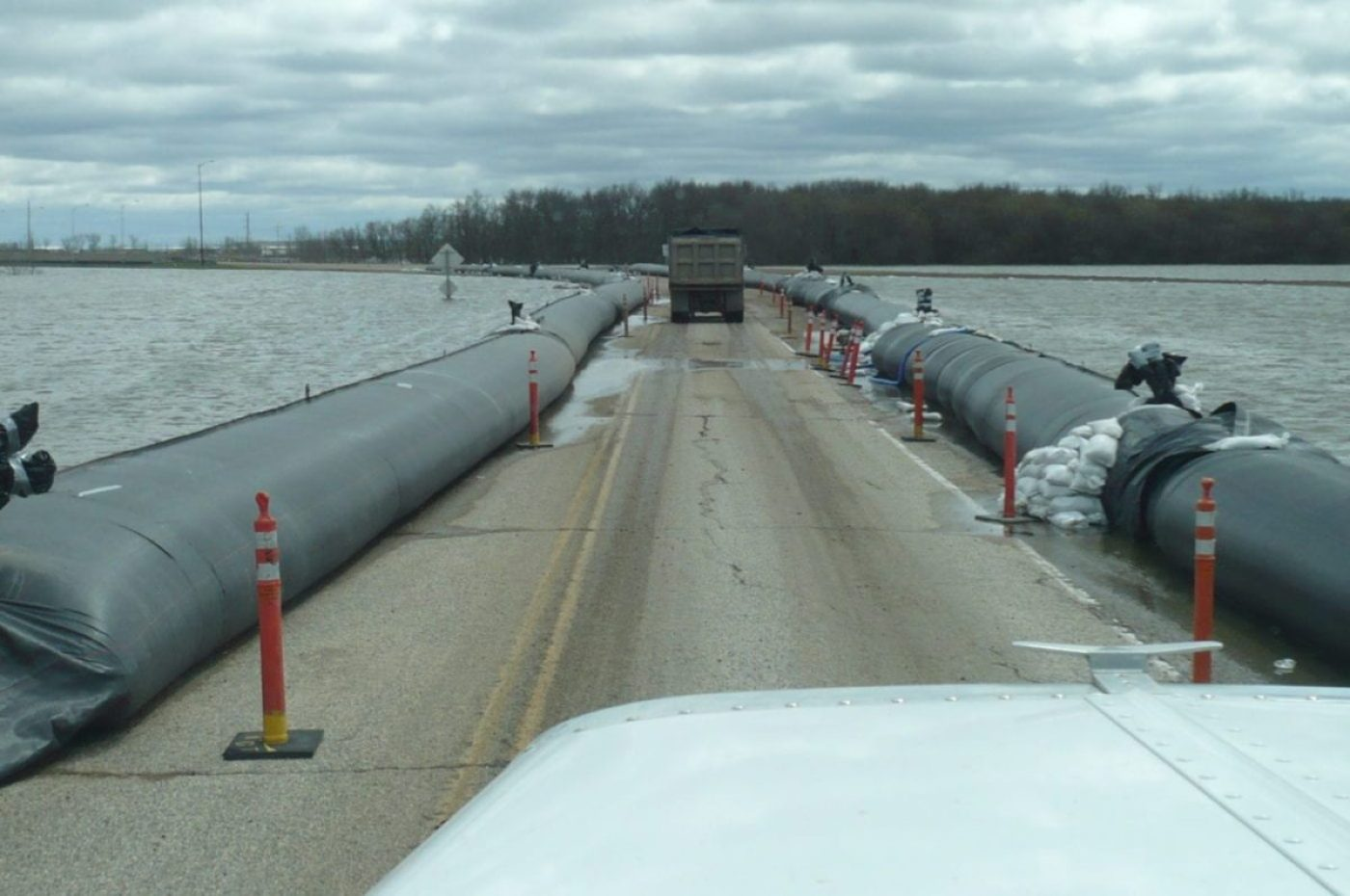 3000 feet of 3-foot tall AquaDams installed on either side of this highway in Brandon, Manitoba, Canada, in 2011. Kept the road open when it otherwise would have flooded. (AquaDam image)