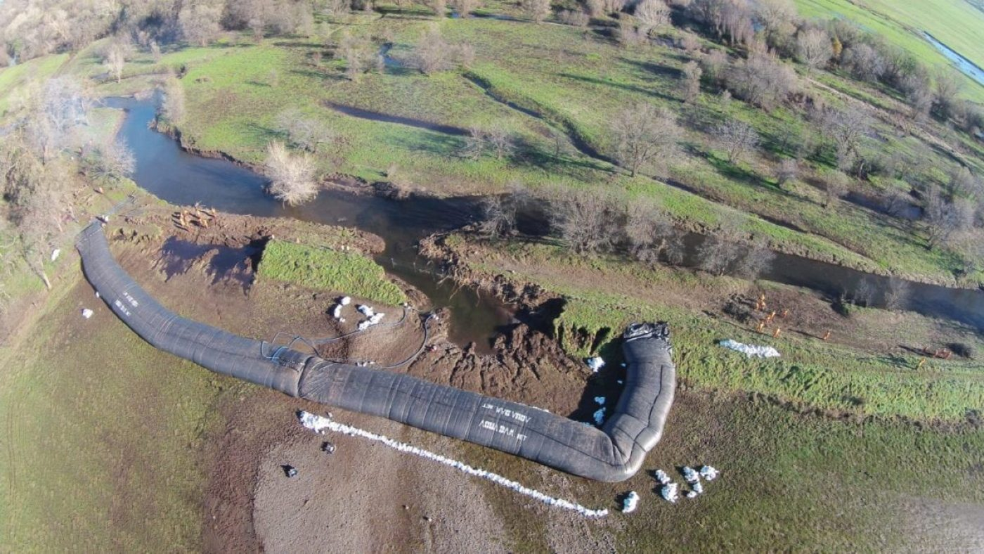 Levee breach isolation achieved with two 8ft tall, 200ft long AquaDams. (AquaDam image)