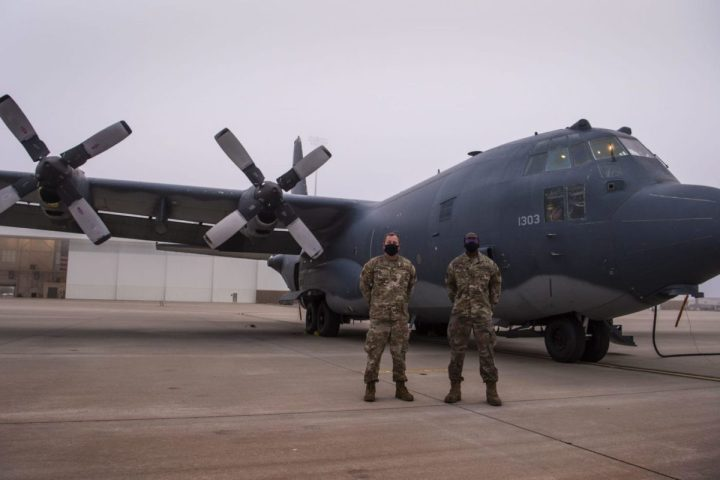 Master Sgt. Kevin Shafer, 16th Aircraft Maintenance Unit crew chief section chief, left, and Staff Sgt. Joshua Ohienmhen, 16 AMU Non-Commissioned Officer in charge, stand in front of an AC-130W Stinger II gunship, Tail No. 1303, prior to the aircraft's final flight before retirement at Cannon Air Force Base, N.M., Oct. 19, 2020. Shafer was Tail No. 1303's Dedicated Crew Chief in 2009 while Ohienmhen served as the most recent DCC for the aircraft. (U.S. Air Force photo by Staff Sgt. Luke Kitterman)