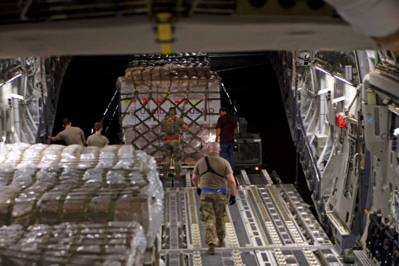 Airmen assigned to the 60th Aerial Port Squadron secure pallets loaded with U.S.-made ventilators onto the cargo floor of a C-17 Globemaster III at Travis Air Force Base, Aug. 27, 2020. The United States provided brand-new, high-quality ventilators to the government of Indonesia to fight COVID-19. (U.S. Air Force photo by SR. Airman Jonathan Carnell)
