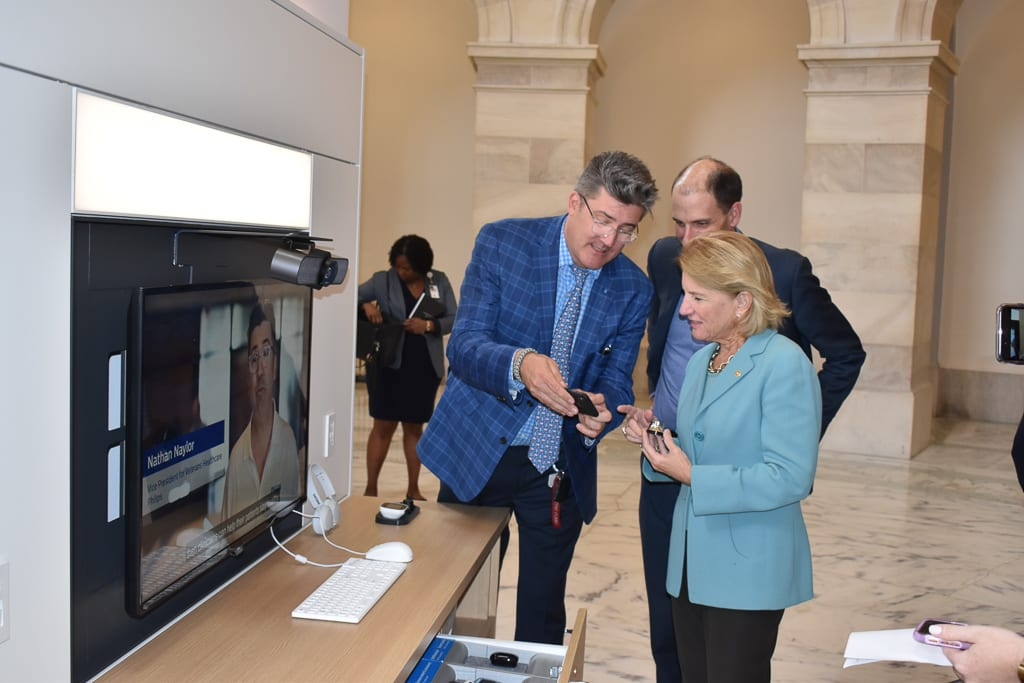 Nathan Naylor of Philips, left, and Dr. Neil Evans, chief officer for the VHA Office of Connected Care, demonstrate ATLAS to U.S. Sen. Shelley Capito, R-W.Va., in November 2019. The goal of ATLAS is to extend VA telehealth to rural and underserved veterans.