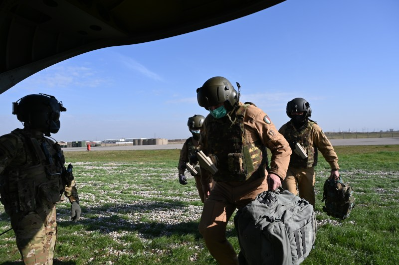 U.S. Soldiers with Task Force Gambler and Italian soldiers with Airmobile Task Group Griffon respond to a downed aircraft scenario during an aerial reaction force exercise. The exercise ensured the coalition partners' cohesiveness in responding to downed aircraft emergencies in hostile environments. (U.S. Army photo by 1st Lt. Alysa Nantarojanaporn)
