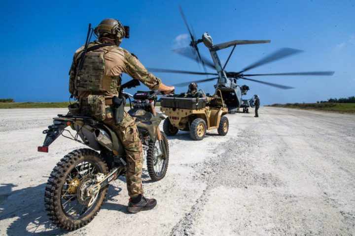 A U.S. Army Soldier with 1st Battalion, 1st Special Forces Group (Airborne), prepares to load a CH-53E Super Stallion with 1st Marine Aircraft Wing during Castaway 21.1 on Ie Shima, Okinawa, Japan, March 17, 2021. The exercise demonstrated the Marine Corps' ability to integrate with the joint force to seize and defend key maritime terrain, provide low-signature sustainment, and execute long-range precision fires in support of naval operations from an expeditionary advanced base. (U.S. Marine Corps photo by Lance Cpl. Ujian Gosun)