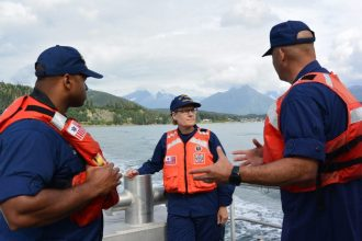 Vice Adm. Linda Fagan, Coast Guard Pacific Area commander, speaks with Chief Petty Officer Mahire A'Giza, Coast Guard Station Juneau officer-in-charge, and Senior Chief Petty Officer Jeremy DeMello, Sector Juneau command senior chief, while underway in Auke Bay, Alaska, Aug. 15, 2018. Fagan visited multiple units in Coast Guard District Seventeen's area of responsibility. (U.S. Coast Guard photo by Seaman Nicole Bridler)