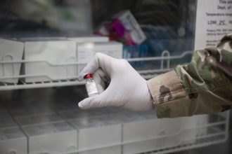 A vial of Army liposome formulation Q (ALF Q) is stored during the start of phase I clinical trials for WRAIR's COVID-19 vaccine, spike ferritin nanoparticle (SpFN) vaccine. ALF Q is an adjuvant, or compound used to boost the immune response, that is co-administered with SpFN. (Walter Reed Army Institute of Research photo by Mike Walter)