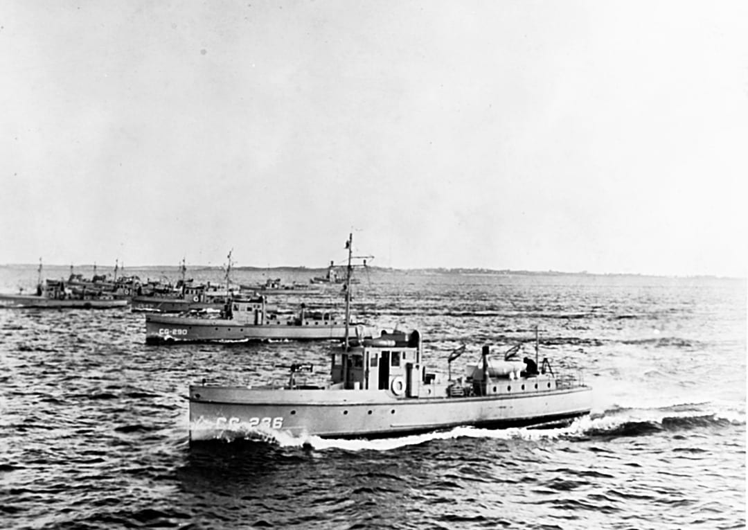 """A flotilla of """"six-bitters."""" More than 200 of the wooden-hulled 75-footers, capable of 15 knots and armed with a 1-pounder cannon forward and various small arms, were built between 1924 and 1925. (Naval History and Heritage Command photo)"""