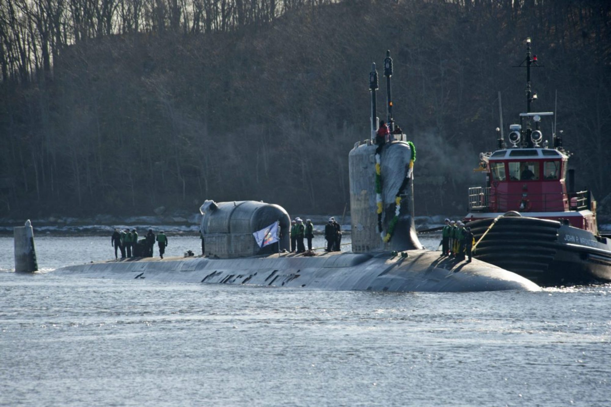 The Virginia-class fast attack submarine USS North Dakota (SSN 784) returns home to Submarine Base New London, Jan. 31, 2019, from its maiden deployment, with a Dry Deck Shelter (DDS) mounted to the deck. Along with a DDS Modernization program to enlarge and improve the six DDS in service, NSW is working to ensure the availability of Virginia-class SSNs to carry the DDS as Ohio-class SSGNs are decommissioned. (U.S. NAVY PHOTO BY NAREWSKI)