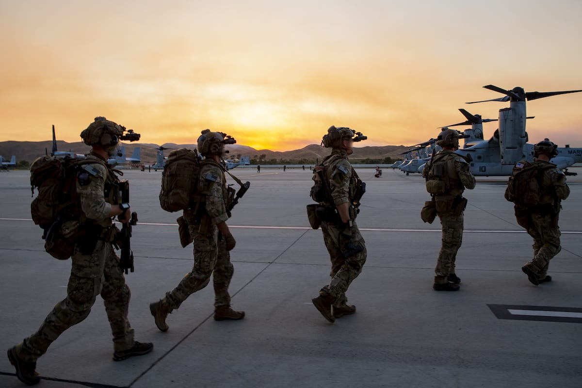 U.S. Marines with U.S. Marine Forces Special Operations Command prepare to board MV-22B Ospreys with Marine Medium Tiltrotor Squadron 164 (Reinforced), 15th Marine Expeditionary Unit, prior to executing a raid for Realistic Urban Training at Marine Corps Air Station Camp Pendleton, California, June 8, 2020. Marines trained in an unfamiliar, urban environment, focusing on tactics, techniques, and procedures applicable to raid operations. (U.S. MARINE CORPS PHOTO BY CPL. PATRICK CROSLEY)