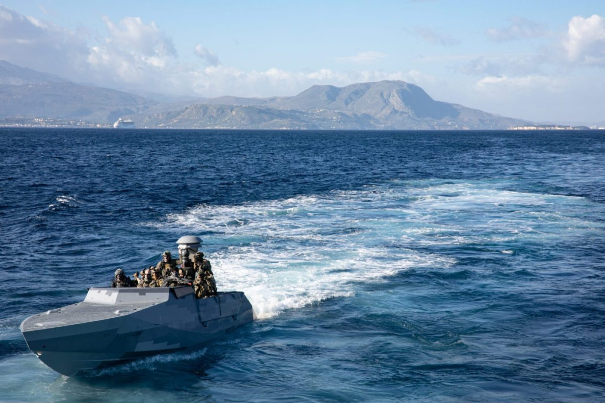 Naval special operations forces from the Greek Underwater Demolition Team (DYK), Cypriot Underwater Demolition Team (UDT), and U.S. Navy Special Warfare Combatant-Craft Crewmen (SWCC) conduct visit board search and seizure (VBSS) evolutions aboard a Combatant Craft Assault (CCA) in Souda Bay, Greece, during a trilateral exercise. (USSOCOM PHOTO BY SGT. MONIQUE O'NEILL)