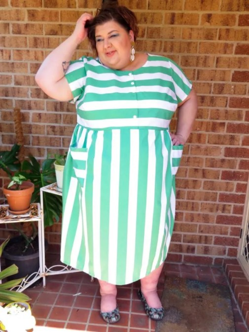 Photo of me wearing my green striped dress, tousling my hair.
