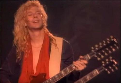 Def-Leppard-Steve-Clark-Playing-Guitar