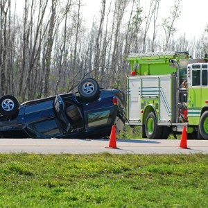 Accident - car flipped over with fire truck