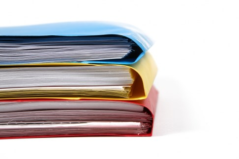 stack of colorful binders in a office