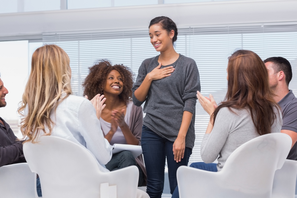http://www.dreamstime.com/royalty-free-stock-photo-happy-patient-has-breakthrough-group-therapy-others-clapping-her-image31010215