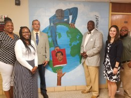 McNair Middle teachers smile in front of mural