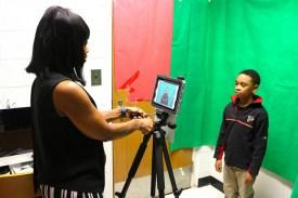 Ms. Jackson records boy on pad-caster