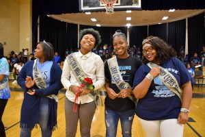 four students on Cedar Grove homecoming court smile