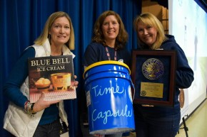 austin staff hold book, time capsule and plaque