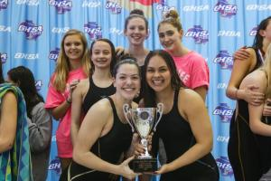 swim team holds championship trophy