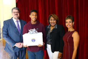 Zach Bryant holds award with principal and CBS46