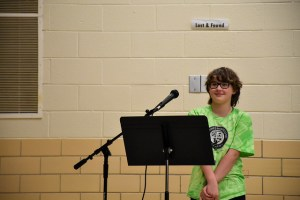 5th grade student at podium