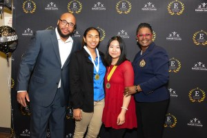 valedictorian and salutatorian stand with DCSD leaders
