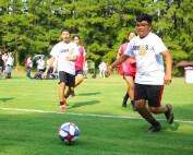 boy student kicks soccer ball
