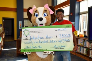 Mr. Hines holds large check