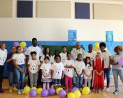Peachcrest elementary students and teachers unveiling interactive playground.