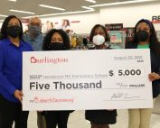 staff-at-henderson-mill-elementary-school-holding-a-five-thousand-dollar-check