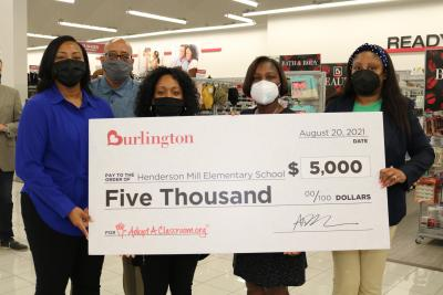 staff at henderson mill elementary school holding a five thousand dollar check