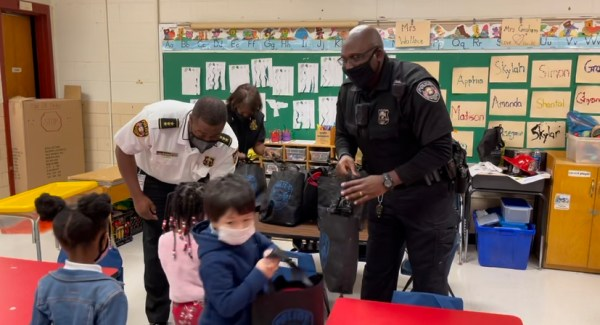three policemen instructing students in a classroom