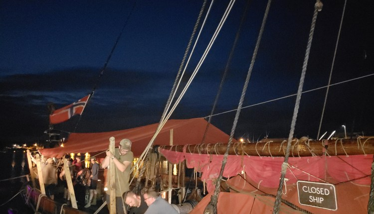 Crew of the Draken Harald Hårfagre getting her set for the night.