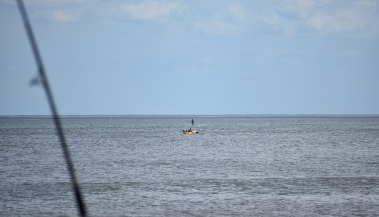 Guy on a motorized  board off the beach in Cape Henlopen State Park