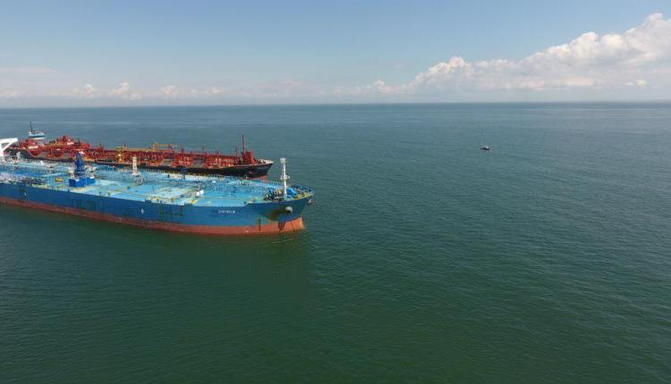Checking  out two ships while lightering to test how well a drone can see any issues from above