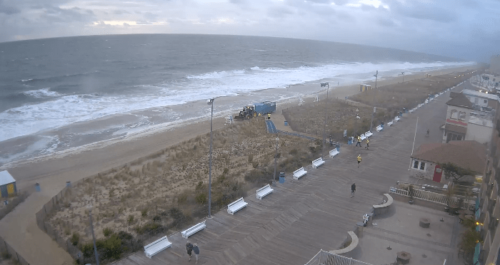 Rehoboth Beach at 7:20 AM  water is almost to the dune lines.