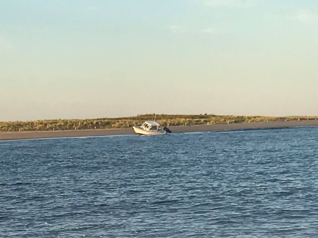 beached boat, the point, cape henlopen state park, parker boats