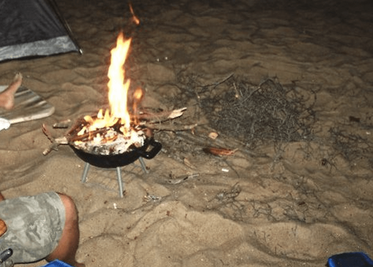 fire at beach, delaware surf fishing
