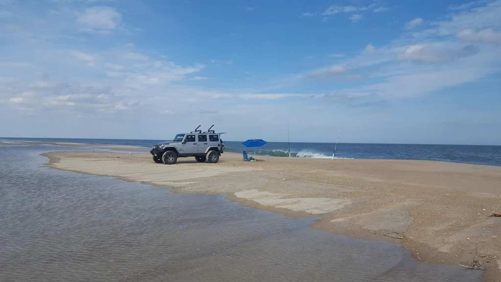 jeep stuck on beach, swales, tide pools, flooded beaches, hurricane larry, delaware state parks, drive on beaches